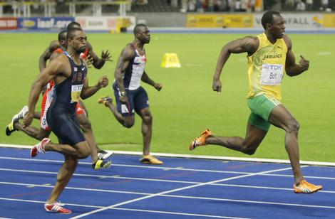 Aiming even higher: Jamaica's Usain Bolt defeats American Tyson Gay in world-record time in the final of the 100 metres at the world titles.